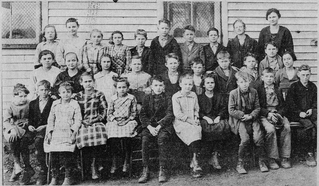 1922 Freetown School. Back L-R: ?, Gertrude Zike, Onedia Stogdill, Amy Cornett, Dillon Hanner, Bert Sprague, Roger Hayes, Joe Lucas, ?, and Reva Bebout(teacher). 2nd Row L-R: Florence Owens, ?, Olive Lucas, ?,?, Carl Thompson, ?,?, Russell Spurgeon, and Dorothy Smith? 1st Row L -R: Thelma Smith, ?, Ruth Harbaugh, ?, Alice Denny, Homer Forgey, ?, Elva Rotert,?, Paul Sprague. - from Winfred (Bud) Cornett, bw 7.32x4.27