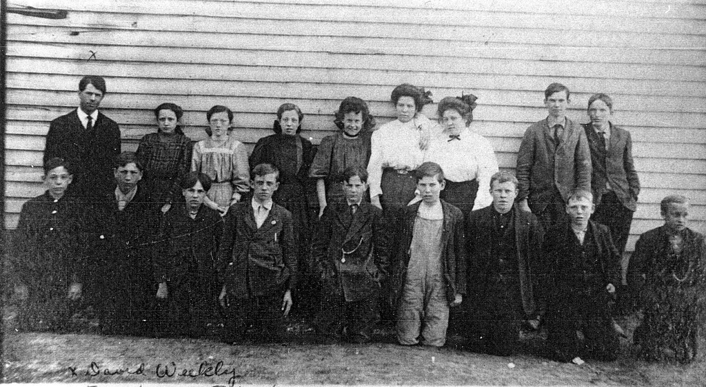 Freetown School, ca 1908, Front L-R: Ralph Harbaugh, Chelcie Bebout, ?, Max Tinch, Bruce Brown, Ray Noe, Earl Spurgeon, Clifford Taylor, Bee Spurgeon. Back L-R: Mae Smith, Goldie Davis, Minnie White, Mable McKain, Alice Denny, Ethel Tinch, Henry Bell, and Virgil Zike. - from Winfred (Bud) Cornett, bw 6.23x3.42