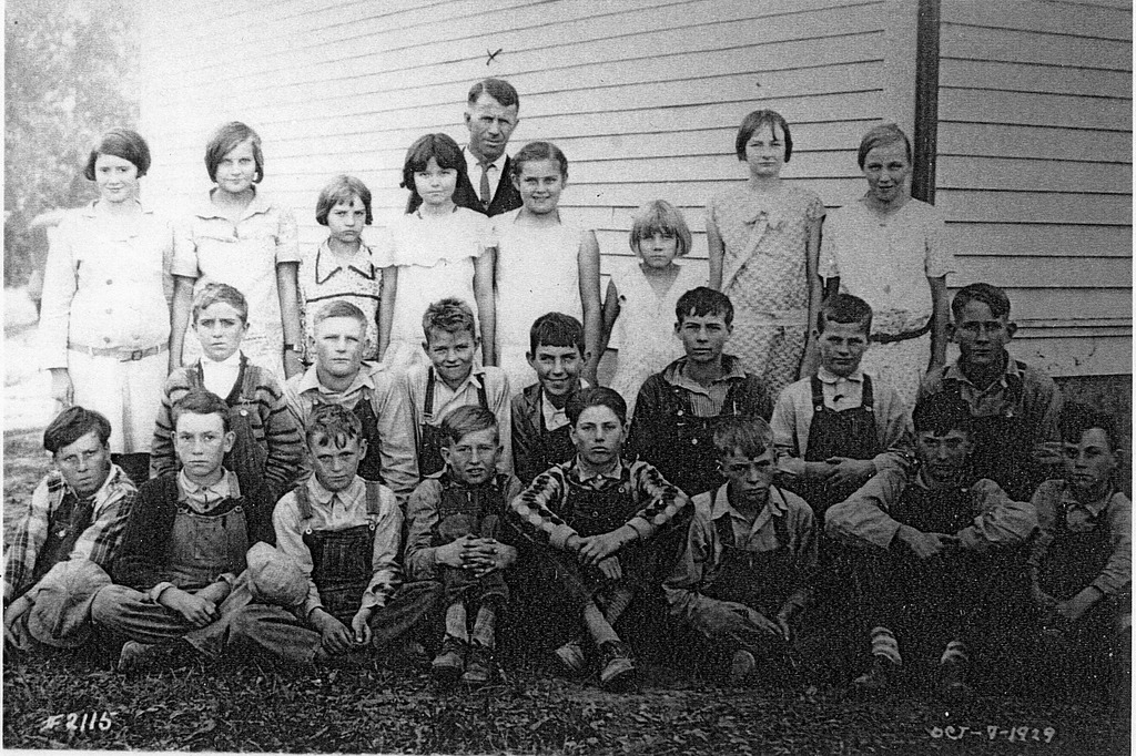 Maumee School in 1929, Front L-R: Forrest Dephue, Stacy George, Burrell Fleetwood, Luther Combs, Carl Starnes, Frank Harrell, Floyd Arthur, and Carl Fleetwood. 2nd Row: Ernie Elkins, Russell Fleetwood, Grover Arthur, Earl Lutes, James McKain, Wesley Fleetwood, and Dean Wray. Back Row: Marjorie Lutes, Mildred Lutes, Thelma Arthur, Fern Henderson, Ruby Lutes, Clara Cheek, Marie Fleetwood, and Lucy Cheek. - from Winfred (Bud) Cornett, bw 6.73x4.48