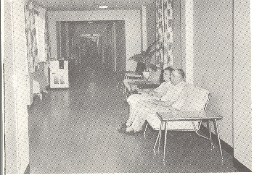 Hospital corridor with comfortable seating, air conditioning, and free coffee. - from Tom Melton - Arvin Folks Magazine, July-August, 1957