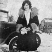 May Mann in outfit with fur collar.