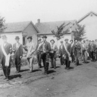 Freetown, Indiana, Memorial Day.  Men carrying flowers for the veterans graves. - from Elaine Allman, bw 5.55x9.58