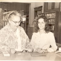 Mrs. Cordes?  and unknown woman at circulation desk - from the Seymour Tribune, bw 6.81x5.61