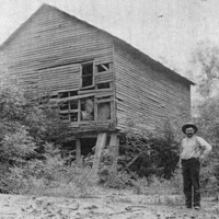 Old Findley Mill in Maumee, built in early 1800's, Theodore Davis in picture (Born 1874, died 1952).