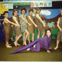 School classroom play, picture from Becky Miller, Seymour, IN., left to right: Dustin Lafferty, Brooke Thomas, Meghan Stout, Adrienne Graessle, Alicia Herzberger, Brad Huddleston (with club). Front - Jenna Miller (dinosaur). - from the Brownstown Banner, 4.88 x 3.48, color.