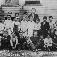 Smith School, October, 1917, Mack Foto, Seymour, IN. Grace Tanner - principal. Located east of Kurtz, 1/2 mile south of Highway 58, 1 and 1/2 miles west of the junction of 58 and 135. Back L-R: Grace Browning, Sophie Beavers, Roy Lyon, Homer Fields. Middle L-R: Mable Matlock, Laurel Trowbridge, Gertrude Browning, Marcus Marion Riley, May Lyon, Myrtle Browning, Susie Aynes Riley, Joe Matlock, Alice Lyon and Ruth Trowbridge. Front L-R: Leroy O'Neil, Hershell Fields, Clarence Trowbridge, Dallas Lyon, Perry Trowbridge, Clarence Callahan, Jessie Trowbridge, Edith Mae Riley, Hazel Katherine Riley and Walter Callahan. - from Winfred (Bud) Cornett, bw 6.71x4.05