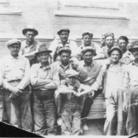 Unidentified group of men and one boy at lumberyard. - from Elaine Allman, bw 6.73x4.57