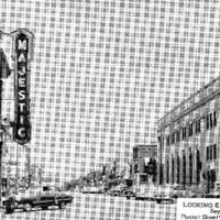 Masonic Lodge building just visible behind Majestic Theater at left.  Former Seymour National Bank is on the right. Elks Lodge behind tree at far right.  West Second St east of Walnut in Seymour IN about 1950