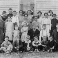 Mort Tabor - teacher, Chester Spurgeon, Myrtle Scott, Agnes Reedy, Hulda Paris, Bertha Adams. Middle: Huce Fields, Sherman Scott, Ova Scott, Forest Scott, Ethel Reedy, Rhonea Fields, Goldie Paris. Front standing - Luvonne Carpenter, Josephine Spurgeon, Tiny Lucas, Lizzy Lucas, Tessa Scott, Harley Scott, Carmel Scott, Frank Adams Alton Scott. Front - seated: George Adams, Eddie Lucas, Orland Paris, George Scott, Virgil Scott, Arnold Fields, Oliver Lucas. (Not in Order) - from Winfred (Bud) Cornett, bw 6.84x10.65