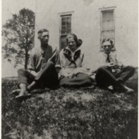 Senior Class of 1921, Freetown, IN, L-R: Gwin (Snap) Bebout, May White, and Kenneth (Beany) Wheeler on the rock pile at the old Freetown School. Snap died in Florida in 1983.He came to the 4th of July Celebration at Freetown every year. Beany died at sea while serving in the Navy. - from Oguerita McKinney, bw 4.68x6.55