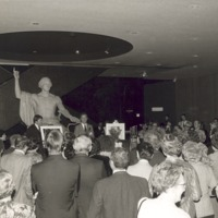 Oct. 31, 1980 Smithsonian Museum, Washington, D.C., in front of a statue of Geo. Washington Phil Robertson addresses members of the American Association of Cereal Chemists during a reception to celebrate the gifts of the historic milling equipment to the Smithsonian. To Phil's right stands Dr. G. Jerry Sharrer.