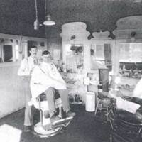 Jackson Hotel barbershop in Vallonia IN, about 1920. Barber Zerah (Zeek) Purdy gives Harry Shoemaker a 30-cent trim.