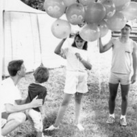 Jackson Co. Fair, 4-H members giving out balloons - from the Brownstown Banner, 4.44 x 5.49, bw