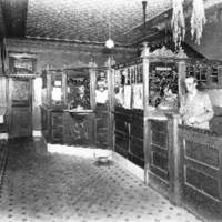 Medora State Bank interior with tobacco hanging from the ceiling, located on East Main Street in 1925