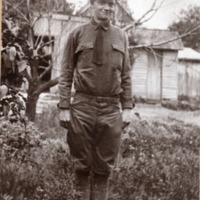 Unidentified Photo of WWI 1918 Soldier in front of shed with tree at left. - from Jackson County Historical Society