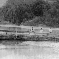 The ferry boat at the Forks of the White and the Muscatatuck Rivers, was owned and operated by Andrew Gullett (with beard) who was the grandfather of Noble (Snooty) Smith. From E.M. Smith. - from Fort Vallonia Museum, 3.38x10.71 bw