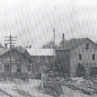 Building south of B and O Railroad tracks in Sparksville, IN, early 1900s. Buildings L-R: B and O Depot, McPike General Store, and Sparksville Handle Factory. - from Paul Carr, bw 10.37x6.58