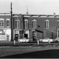1950 businesses along railroad tracks, Colonial cafe is on the corner  and the building on the end left is a tavern. - from Elaine Allman, bw 4.51x3.55