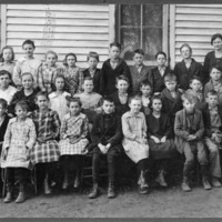 Freetown School Old Building - elementary grades, teacher Reva Bebout. Mallay Gertrude, Amy Cornett, Dillion Hanners, Bert Sprague, Rodger Hayes, Joe Lucas, Florence Owens, Olive Lucas, Dorothy Smith, Russell Denny, Ruth Harbaugh, Alice Denny, Homer Forgey. Susie ?, Elva Rotert, Parsley ?, Paul Sprague, Bruce Zike? Thelma Smith, Carl Thompson, Weekly, Weekly.  - from the Brownstown Banner, 7.12 x 5.25, bw