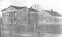 First Public School erected at Medora, In, ca 1867, torn down May, 1897, was at NE edge of Medora. Behind is Lanning Baptist Church, latter moved to N. Riley Street in Medora. It was used as a funeral home and telephone exchange and a home, still standing. - from Paul Carr